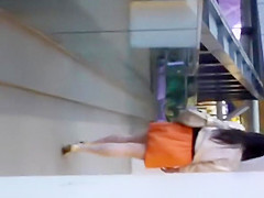 woman in orange skirt upskirted