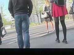 Girl in red short skirt and black leggings upskirted