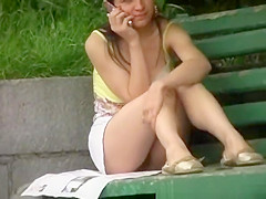 Chick seating in public park bench upskirt