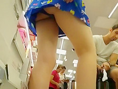Teen in colorful blue mini dress upskirt