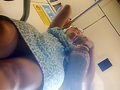 woman with glasses upskirted in the train
