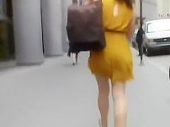 woman in short yellow dress