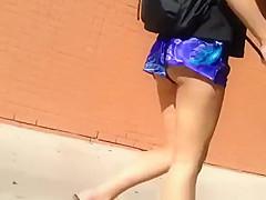 Girl walking in street butt cheeks