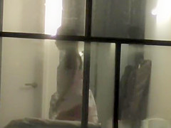 Voyeur neighbor films couple through window