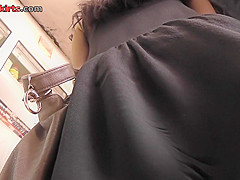Girl in mini skirt shows her amazing ass in upskirt vid