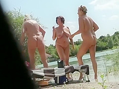Peeping on mature nudist women