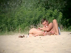 Hot naked girl cuddles on the beach