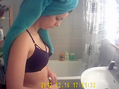 Hot girl's tits spied while washing teeth