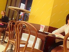 Upskirt of a lonely girl in a coffee shop