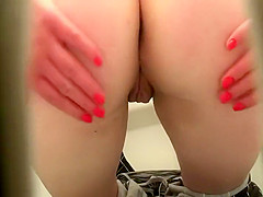Spread buttocks while pissing