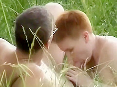 Couple doing their stuff in the grass