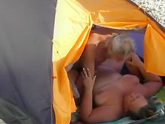 Fat woman fucked in the beach tent