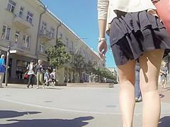 Summer breeze lifts milf's skirt