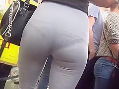 Black thong peeks thru grey leggings