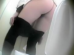 She pulls pantyhose down to pee