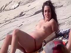 Sexy brunette spied on a beach