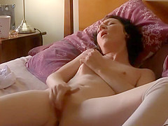 Delicate girl reading a porn magazine