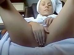 Mature woman masturbates after shower
