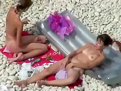 Cute nudist girls spied as they chit chat