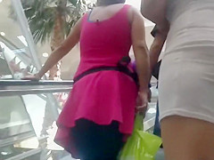 Sheer skirt reveals milf's black thong