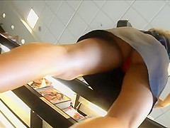 Checking out an upskirt of red panties