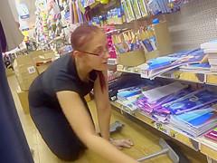 Store clerk bending over in front of me
