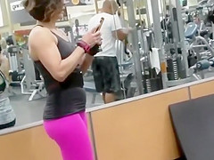 Strong woman voyeured in the gym