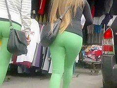 Two asses in tight green leggings
