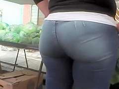 Charming butt of a girl buying vegetables