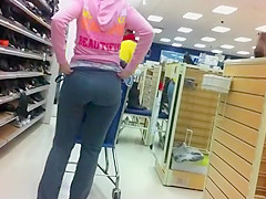Teenage chick bends down to try shoes