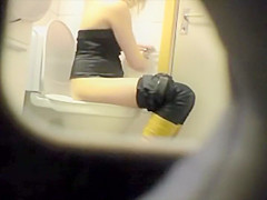Peeping her through a public toilet hole