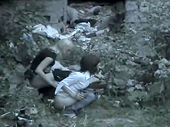 two cute girls caught pissing outside