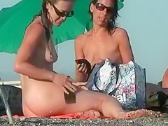 Two hot women spied on a beach