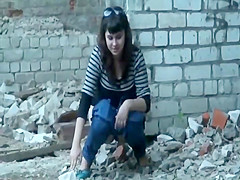Women caught pissing in an old building