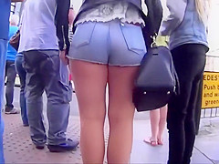 Shy girl tries to pull hot pants down