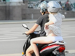 Girl on motorcycle shows some skin