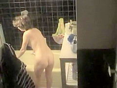 Sexy milf preparing herself a bath