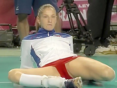 pro sport babe stretches on the floor