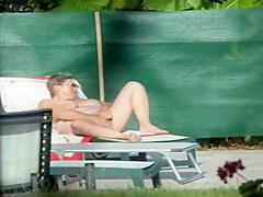 Milf thinks she's all alone at a pool