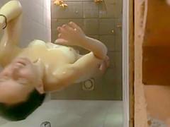 Girl notices a hidden shower camera