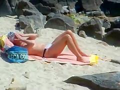Peeping on a sun tanning woman