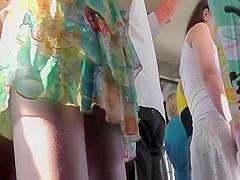 Alluring ass under a short summer dress