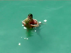 Couple kissing and fucking in the water