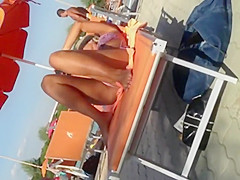 Milf lying by the pool and touching pussy