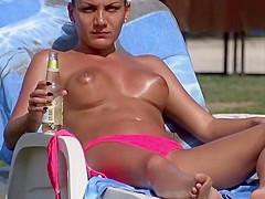Topless girl smokes and drinks