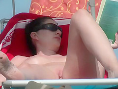 Voyeur films her shaved pussy