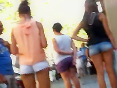 Two girls with shorts in their butt cracks