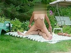 Topless sunbathing on balcony