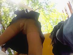 Upskirt waiting the bus