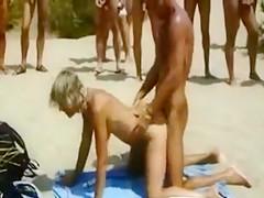 Couple Fucks on a Public Beach with Audience